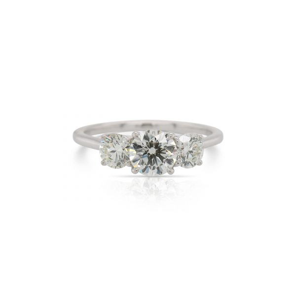 This 3 stone diamond engagement ring by The Forevermark Tribute™ Collection is crafted from 18k white gold and features a 0.71 carat center diamond and 0.65 total carat side diamonds.