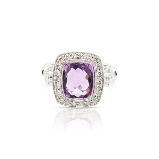 This amethyst and diamond ring by Rafael is crafted from 14k white gold and features a 3.00 carat cushion shaped amethyst and 0.35 total carats of diamonds around the halo.