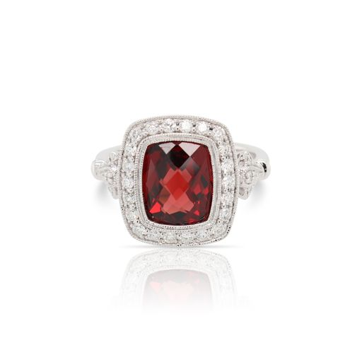 This garnet and diamond ring by Rafael is crafted from 14k white gold and features a 3.75 carat cushion garnet and 0.34 total carats of diamonds.