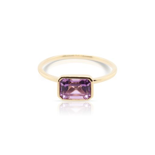 This solitaire amethyst ring by Rafael is crafted from 14k yellow gold and features a 1.00 carat emerald cut amethyst.