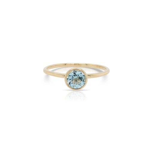 This solitaire blue topaz ring by Rafael is crafted from 14k yellow gold and features a 0.62 carat round blue topaz.