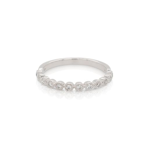 This diamond ring from Forevermark Tribute™ Collection is crafted from 18k white gold and features 0.16 total carats of bezel set diamonds surrounded by milgrain halos.