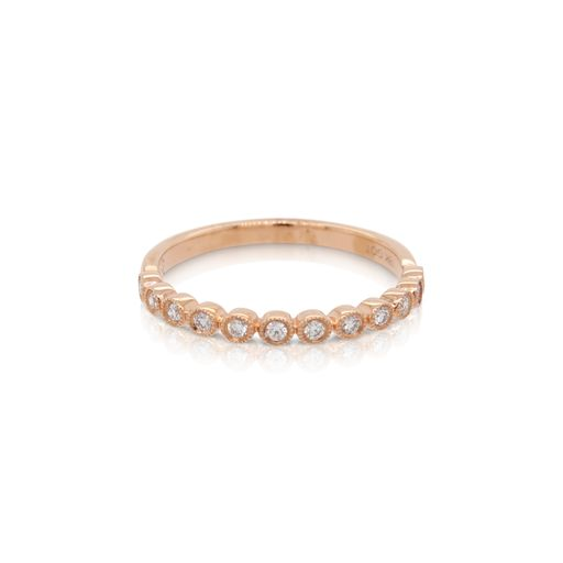 This diamond ring from Forevermark Tribute™ Collection is crafted from 18k rose gold and features 0.16 total carats of bezel set diamonds surrounded by milgrain halos.