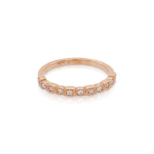 This stackable diamond ring from Forevermark Tribute™ Collection is crafted from 18k rose gold and features 0.12 total carats of diamonds surrounded by alternating square and round milgrain halos.
