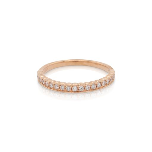 This diamond ring from Forevermark Tribute™ Collection is crafted from 18k rose gold and features 0.20 total carats of half bezel set diamonds.
