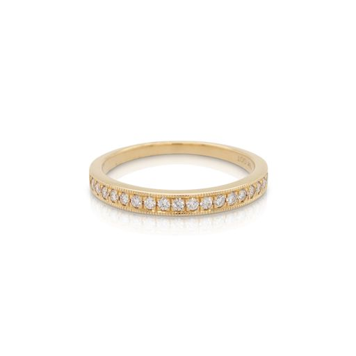 This diamond stackable ring from Forevermark Tribute™ Collection is crafted from 18k yellow gold and features 0.20 total carats of diamonds with a milgrain edge.