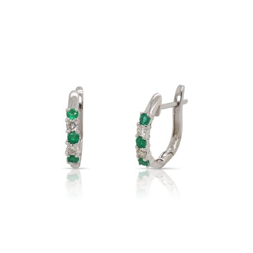 This pair of emerald and diamond hoop earrings by Rafael is crafted from 14k white gold and features 0.30 total carats of emeralds and 0.15 total carats of diamonds.