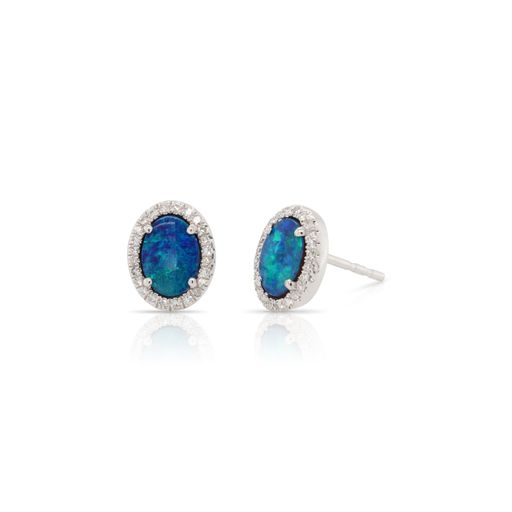 This pair of Australian opal and diamond earrings by Rafael is crafted from 14k white gold and features 1.25 total carats of oval Australian opals and 0.12 total carats of diamonds around the halo.