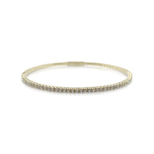This diamond bangle bracelet by Rafael is crafted from 14k yellow gold and features 2.44 total carats of diamonds.
