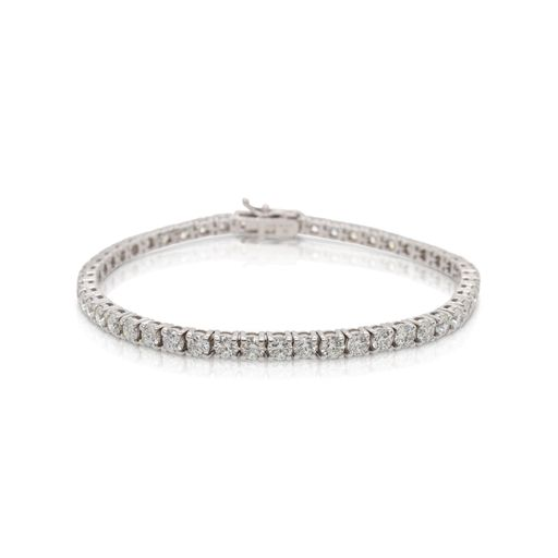 This diamond tennis bracelet from Forevermark Tribute™ Collection is crafted from 14k white gold and features 7.00 total carats of diamonds.