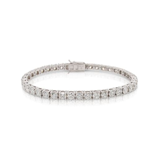 This diamond tennis bracelet from Forevermark Tribute™ Collection is crafted from 18k white gold and features 10.00 total carats of diamonds.