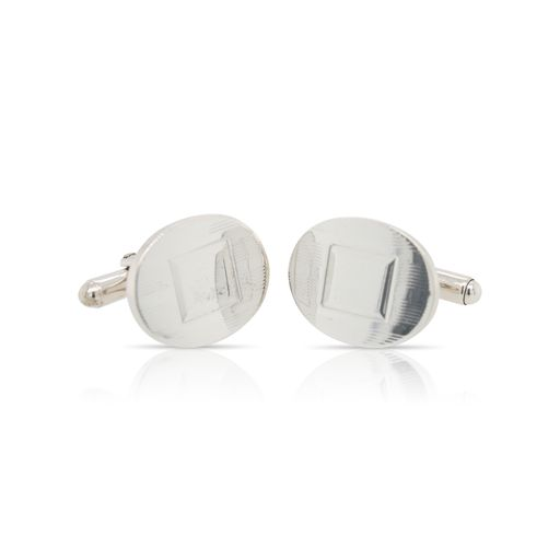 This pair of oval engraved cufflinks by Tiffany & Co is crafted from sterling silver and features a square engraved into them.