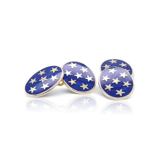 This pair of cufflinks by Deakin and Francis is crafted from 9k yellow gold and features white stars on blue oval cufflinks.