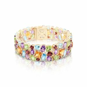 This multicolor bracelet is crafted from 14k yellow gold and features citrine, peridot, garnet, amethyst, blue topaz, and 0.32 total carats of diamonds.