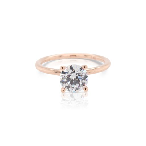 This diamond engagement ring mounting by Sylvie is crafted from 14k rose gold and is for a 1.25 carat diamond. The center diamond is chosen separately.