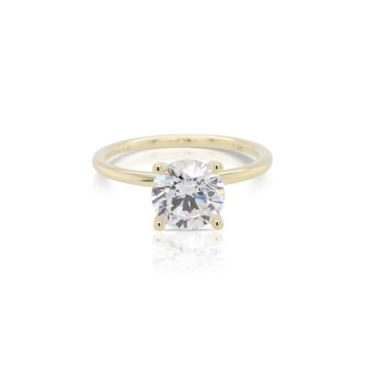 This diamond engagement ring mounting by Sylvie is crafted from 14k yellow gold and is for a 1.50 carat diamond. The center diamond is chosen separately.