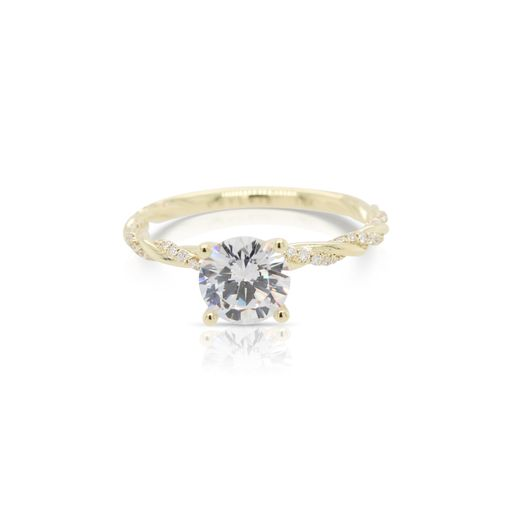 This diamond engagement ring mounting by Sylvie is crafted from 14k yellow gold and features 0.15 total carats of diamonds along the twisted shank. The center diamond is chosen separately.