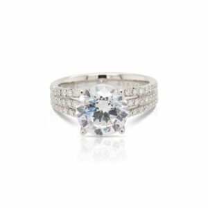 This diamond engagement ring mounting by Sylvie is crafted from 14k white gold and features 0.46 total carats of diamonds along the 3 row shank. The center diamond is chosen separately.