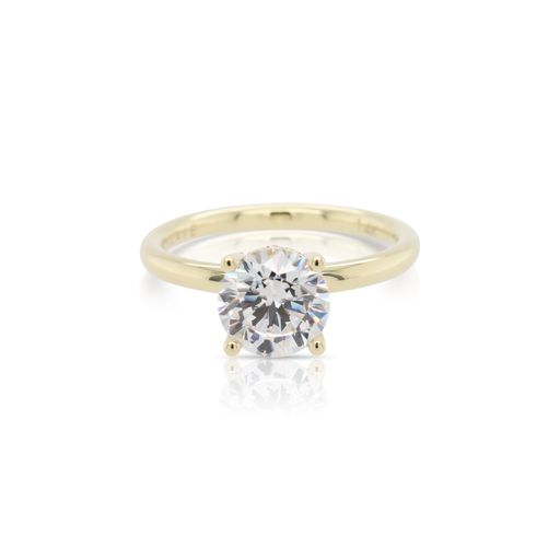 This diamond engagement ring mounting by Sylvie is crafted from 14k yellow gold and features 0.12 total carats of diamonds in the gallery. The center diamond is chosen separately.