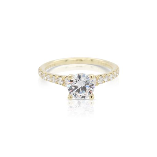 This diamond engagement ring mounting by Sylvie is crafted from 14k yellow gold and features 0.47 total carats of diamonds along the sides. The center diamond is chosen separately.