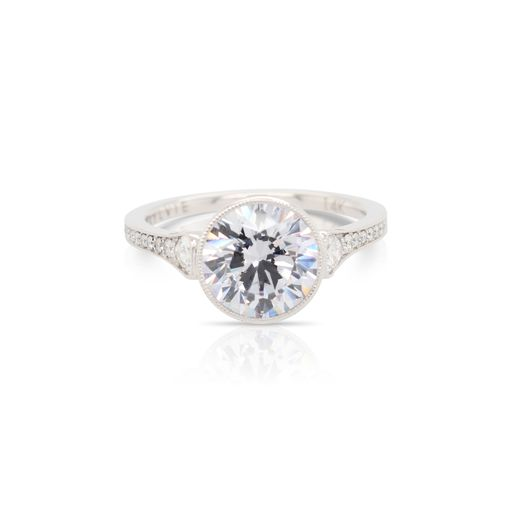 This diamond engagement ring mounting by Sylvie is crafted from 14k white gold and features 0.32 total carats of diamonds along the sides. The center diamond is chosen separately.