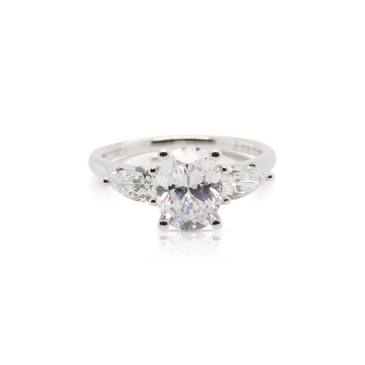 This diamond engagement ring mounting by Sylvie is crafted from 14k white gold and features 0.60 total carats of pear shaped side diamonds. The center diamond is chosen separately.