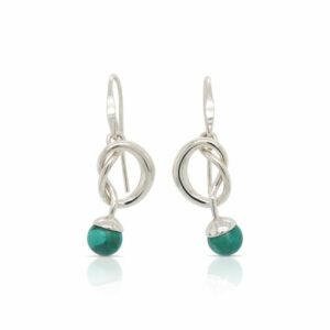 This pair of turquoise knotty earrings by Ed Levin is crafted from sterling silver and features two turquoise.