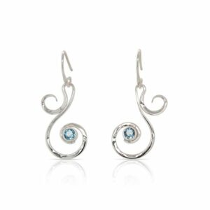 This pair of blue topaz Fiddlehead earrings by Ed Levin is crafted from sterling silver and features two round blue topaz.