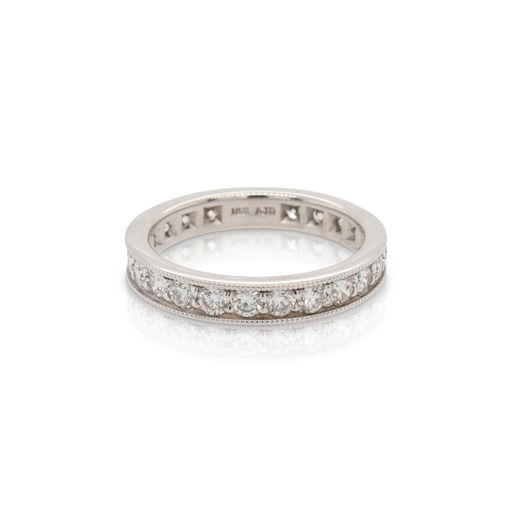 This diamond ring is crafted from 18k white gold and features 1.68 total carats of diamonds with milgrain edges.