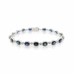 This sapphire and diamond bracelet by Rafael is crafted from 14k white gold and features 9.00 total carats of oval sapphires and 0.13 total carats of diamonds