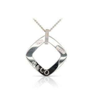 This open square pendant by Tiffany & Co. is crafted from sterling silver and features a Tiffany & Co. 1837 engraving on the back. This piece includes matching chain.