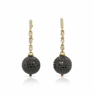 This pair of dangle earrings is crafted from 18k yellow gold and features 3.40 total carats of black spinel on the ball and 0.36 total carats of diamonds.