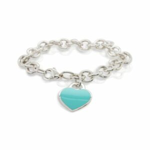 This charm bracelet by Tiffany & Co. is crafted from sterling silver and features a Tiffany blue heart charm.