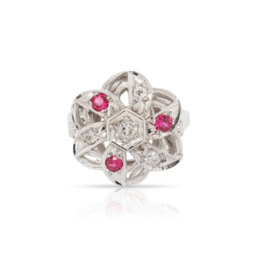 This ruby and diamond floral ring is crafted from 14k white gold and features 0.31 total carats of diamonds and 0.18 total carats of rubies.