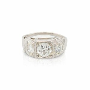 This three stone engagement ring is crafted from platinum and features a 0.92 carat old European cut center diamond and 0.34 total carats of side diamonds.