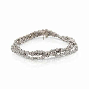 This tri strand diamond bracelet is crafted from 18k white gold and features 4.50 total carats of diamonds.