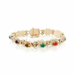 This multicolored bracelet is crafted from 14k yellow gold and features multiple colorful natural stones.