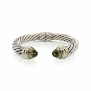 This cable bracelet by David Yurman is crafted from sterling silver and 14k yellow gold and features citrine accents.